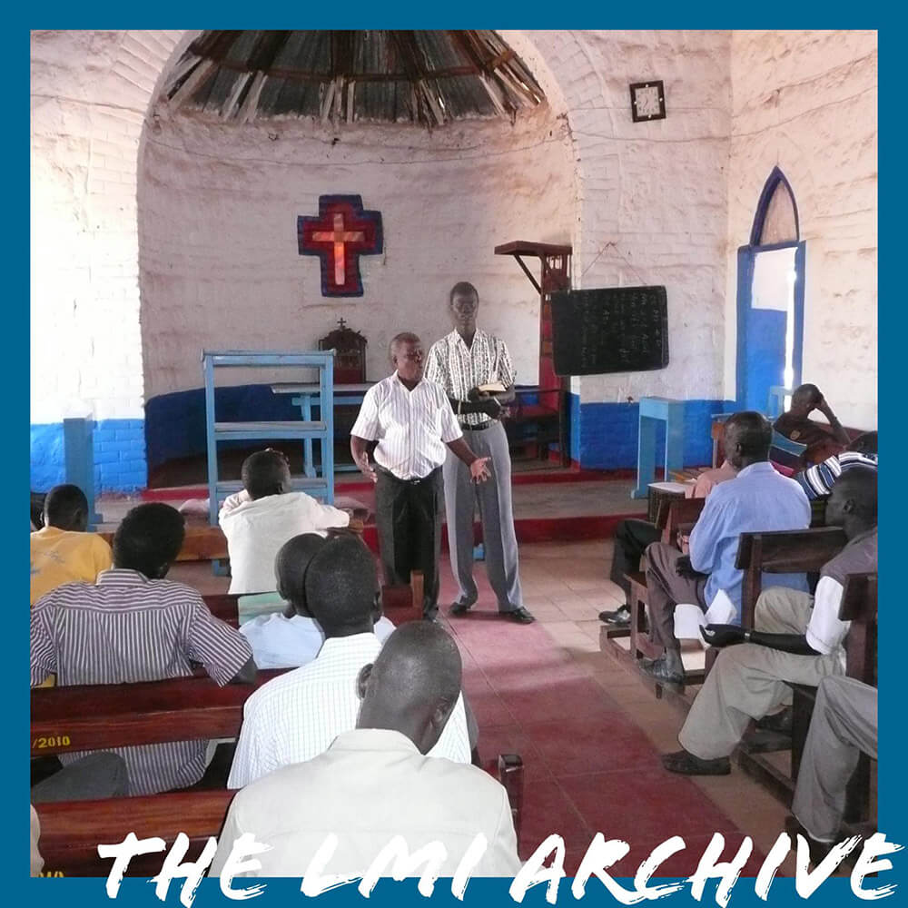 Pastor Josiah preaching in his Church in Kenya in 2011 during an LMI Overseas Mission Trip